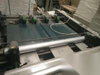 出售九成新覆膜拉纸机
